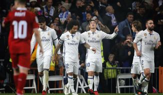 Real Madrid's James from Colombia, center right, celebrates after scoring a goal during a Spain's King's Cup soccer match between Real Madrid and Sevilla C.F. at the Santiago Bernabeu stadium in Madrid, Spain, Wednesday, Jan. 4, 2017. (AP Photo)
