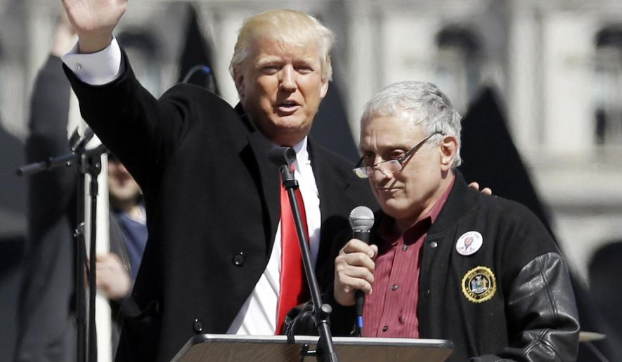 FILE - In this April 1, 2014, file photo, Donald Trump, left, is joined by Carl Paladino during a gun rights rally at the Empire State Plaza in Albany, N.Y. On Wednesday, Jan 4, 2017, the wealthy businessman who co-chaired Trump's campaign in New York, refuted reports that he was on the outs with the transition team and not welcome at a fund-raiser Thursday, Jan. 5, in his hometown of Buffalo, N.Y. (AP Photo/Mike Groll, File)