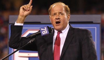 Chris Berman introduces former Buffalo Bills Hall of Fame defensive end Bruce Smith during his jersey retirement ceremony at halftime of an NFL football game, in Orchard Park, N.Y., Sept. 15, 2016. Berman isn't disappearing from in front of the cameras or from behind the microphones. He's simply stepping to the side a bit. The longtime ESPN fixture is giving up his regular on-air NFL and baseball spots for a new role at the network.(AP Photo/Bill Wippert, File) ** FILE **