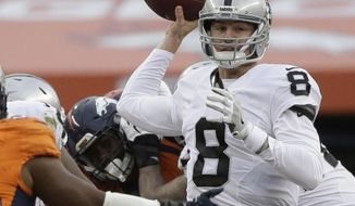 FILE - In this Sunday, Jan. 1, 2017, file photo, Oakland Raiders quarterback Connor Cook passes against the Denver Broncos in the first half of an NFL football game in Denver. The Raiders play the Houston Texans in a Wild Card game on Saturday, Jan. 7. (AP Photo/Jack Dempsey, File)