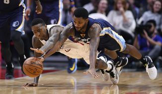 Los Angeles Clippers guard Jamal Crawford, left, dives for a loose ball along with Memphis Grizzlies guard Troy Daniels during the second half of an NBA basketball game, Wednesday, Jan. 4, 2017, in Los Angeles. (AP Photo/Mark J. Terrill)