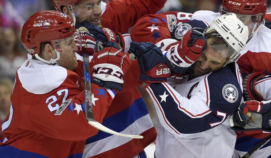 Columbus Blue Jackets left wing Nick Foligno (71) tangles with Washington Capitals defenseman Karl Alzner (27) during the second period of an NHL hockey game, Thursday, Jan. 5, 2017, in Washington. (AP Photo/Nick Wass)