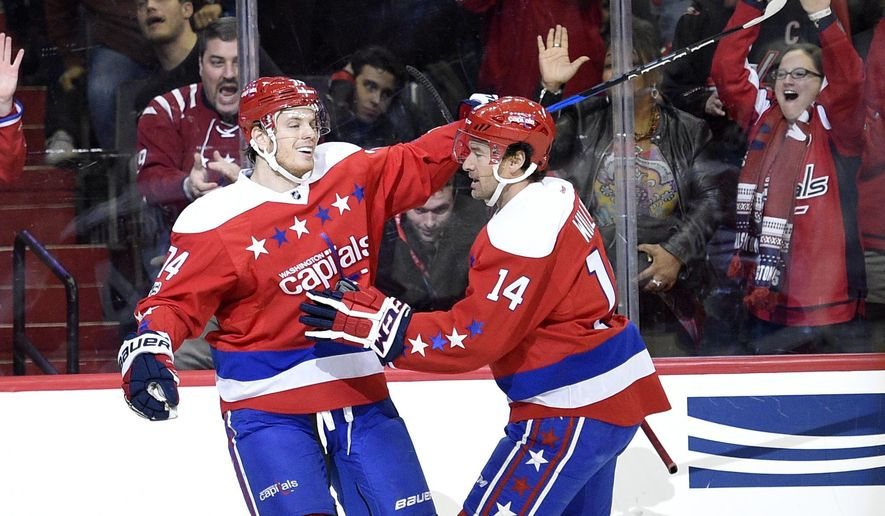 Washington Capitals defenseman John Carlson (74) celebrates his goal with Justin Williams (14) during the first period of an NHL hockey game against the Columbus Blue Jackets, Thursday, Jan. 5, 2017, in Washington. (AP Photo/Nick Wass)