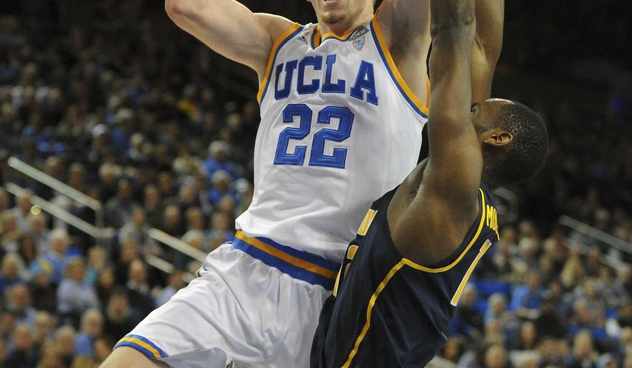 UCLA forward T.J. Leaf (22) turns for a jumper over California's Roger Moute A Bidias (12) during the first half of an NCAA college basketball game in Los Angeles, Thursday, Jan. 5, 2017. (AP Photo/Michael Owen Baker)