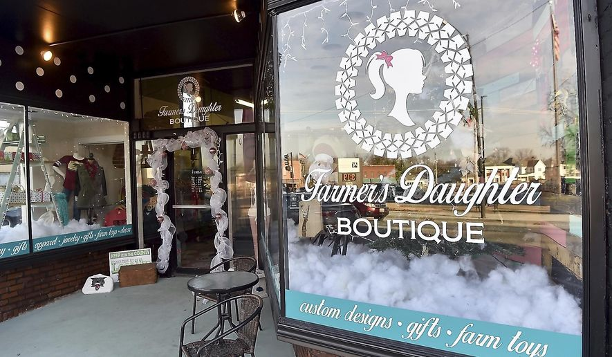 ADVANCE FOR USE SUNDAY, JAN. 8, 2017 AND THEREAFTER - This Dec. 20, 2016  photo shows Farmer's Daughter Boutique that offers clothes, custom designs, gifts and more from its location on Main Street in Anna, Ill. Along South Main Street, new businesses have opened in the past year. Also, several buildings have been sold, and work is in progress to prepare them for new businesses. One current trend in business is to move downtown, as documented in a Smart Growth America report in June 2015. Anna is also seeing this trend. (Richard Sitler/The Southern, via AP)
