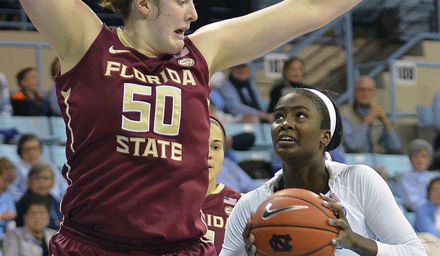 North Carolina's Destinee Walker, right, battles Florida States' Chatrice White for a shot, Thursday, Jan. 5, 2017, in Chapel Hill, N.C. (Bernard Thomas/The Herald-Sun via AP)