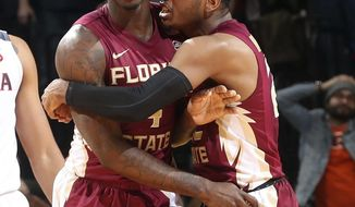 Florida State guard Dwayne Bacon (4) reacts alongside teammate Xavier Rathan-Mayes (22) after shooting the winning 3-point shot in the closing seconds of the second half of an NCAA college game against Virginia, Saturday, Dec. 31, 2016, in Charlottesville, Va. Florida State won 60-58. (AP Photo/Andrew Shurtleff)