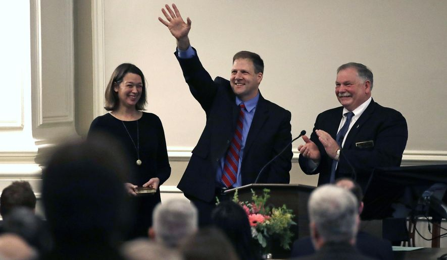 "New Hampshire Gov. Chris Sununu waves as he stands with his wife Valerie, left, and Speaker of the House Shawn Jasper after taking the ""Oath of Office"" at the State House in Concord, N.H., Thursday, Jan. 5, 2017. Sununu, the first Republican to hold the corner office in a dozen years, follows in the footsteps of his father, former N.H. Governor John H. Sununu. (AP Photo/Charles Krupa)"