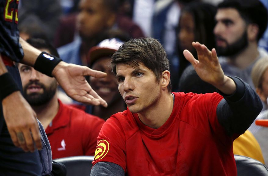 Atlanta Hawks guard Kyle Korver, right, greets forward Thabo Sefolosha who comes to the bench in the first half of an NBA basketball game against the Atlanta Hawks in New Orleans, Thursday, Jan. 5, 2017. (AP Photo/Gerald Herbert)