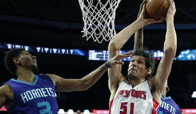 Detroit Pistons center Boban Marjanovic (51) grabs a rebound next to Charlotte Hornets guard Jeremy Lamb (3) during the first half of an NBA basketball game, Thursday, Jan. 5, 2017, in Auburn Hills, Mich. (AP Photo/Carlos Osorio)