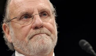 FILE - In this Thursday, Dec. 15, 2011, file photo, former MF Global Holdings Ltd. Chairman and Chief Executive Officer Jon Corzine testifies on Capitol Hill in Washington before the House Financial Services Committee. Corzine, the former New Jersey governor who led the collapsed brokerage firm MF Global, was ordered to pay a $5 million penalty for his role in the firm's alleged illegal use of almost $1 billion in customer funds. A federal court in Manhattan on Thursday, Jan. 5, 2017, granted the order against Corzine to the U.S. Commodity Futures Trading Commission, which brought civil charges against him in 2013. (AP Photo/Susan Walsh, File)