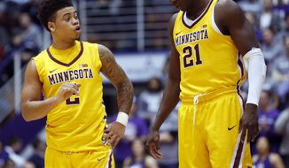 Minnesota guard guard Nate Mason, left, talks with center Bakary Konate during the first half of an NCAA college basketball game against Northwestern Thursday, Jan. 5, 2017, in Evanston, Ill. (AP Photo/Nam Y. Huh)