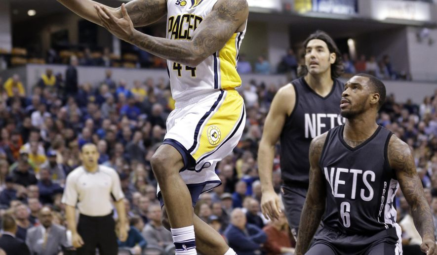 Indiana Pacers guard Jeff Teague (44) shoots in front of Brooklyn Nets guard Sean Kilpatrick (6) during the first half of an NBA basketball game in Indianapolis, Thursday, Jan. 5, 2017. (AP Photo/Michael Conroy)