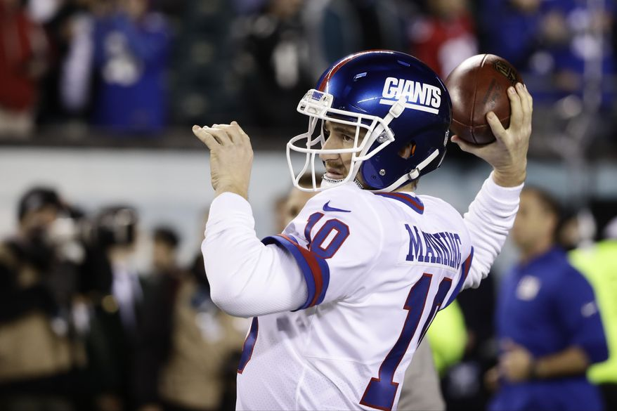 FILE - In this Dec. 22, 2016, file photo, New York Giants' Eli Manning warms up before an NFL football game against the Philadelphia Eagles,in Philadelphia. The Giants play against the Green Bay Packers in a Wild Card playoff game on Sunday, Jan. 8.(AP Photo/Matt Rourke, File)