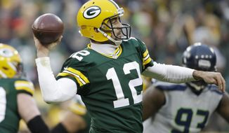 FILE - In this Dec. 11, 2016, file photo, Green Bay Packers' Aaron Rodgers drops back during the first half of an NFL football game against the Seattle Seahawks, in Green Bay, Wis. The Packers play against the New York Giants in a Wild Card playoff game on Sunday, Jan. 8.(AP Photo/Jeffrey Phelps, FIle)