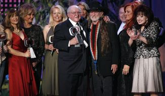 "FILE - In this April 14, 2007, file photo, producer Sam Lovullo, center left and singer Willie Nelson, right along with the cast of the television show ""Hee Haw"" accept the Entertainer's Award during the 5th Annual TV Land Awards in Santa Monica, Calif. Publicists the Brokaw Company said Thursday, Jan. 5, 2017, that Lovullo died at his home in Los Angeles on Tuesday. He had been suffering from heart disease. He was 88. (AP Photo/Gus Ruelas, File)"