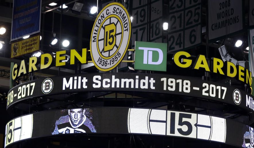 The Boston Bruins honor Bruins legend Milt Schmidt prior to an NHL hockey game against the Edmonton Oilers, Thursday, Jan. 5, 2017, in Boston. Schmidt, who was elected to the Hockey Hall of Fame in 1961, is the only person in Bruins history to have served the club as a player, captain, coach and general manager. Schmidt died on Wednesday at the age of 98. (AP Photo/Elise Amendola)