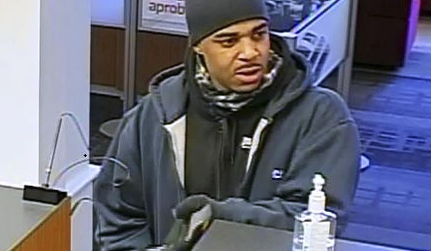 This surveillance photo released by the Federal Bureau of Investigation shows a man who attempted to rob a Bank of America branch Thursday, Jan. 5, 2017, in Cambridge, Mass. The FBI said the suspect resembles recently escaped federal prisoner James Morales, who escaped from the Wyatt Detention Facility in Central Falls, R.I., on Saturday, Dec. 31, 2016. (Federal Bureau of Investigation via AP)
