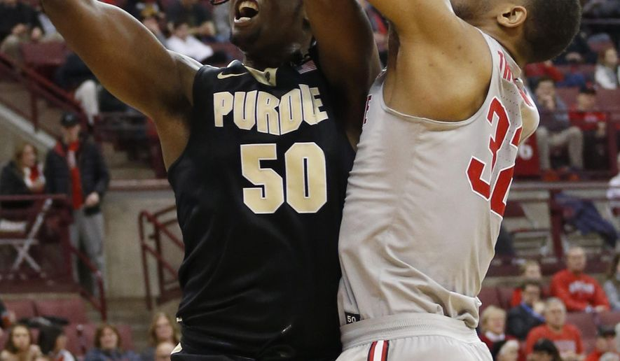 Purdue's Caleb Swanigan, left, is fouled by Ohio State's Trevor Thompson during the first half of an NCAA college basketball game Thursday, Jan. 5, 2017, in Columbus, Ohio. (AP Photo/Jay LaPrete)