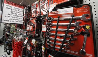 FILE - A May 18, 2011 file photo shows an assortment of Craftsman wrenches at a Sears store in Bethel Park, Pa. Sears is selling its well-known Craftsman brand to Stanley Black & Decker Inc., which plans to grow the tool brand by selling its products at more stores. Shares of Hoffman Estates, Illinois-based Sears Holdings Corp shares rose 7.5 percent to $11.14 before the stock market open Thursday, Jan. 5, 2017.  (AP Photo/Gene J. Puskar, File)