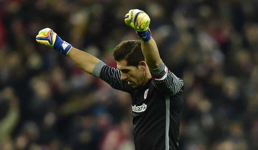Athletic Bilbao's goalkeeper Gorka Iraizos, celebrates his side scoring their second goal,  during the Spanish Copa del Rey, 16 round, first leg soccer match, between Athletic Bilbao and  FC Barcelona, at San Mames stadium, in Bilbao, northern Spain, Thursday, Jan.5, 2017. (AP Photo/Alvaro Barrientos)