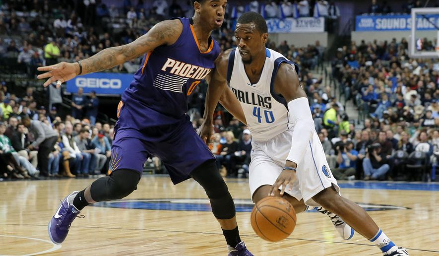 Phoenix Suns' Marquese Chriss (0) guards against a move to the basket by Dallas Mavericks' Harrison Barnes (40) in the first half of an NBA basketball game, Thursday, Jan. 5, 2017, in Dallas. (AP Photo/Tony Gutierrez)