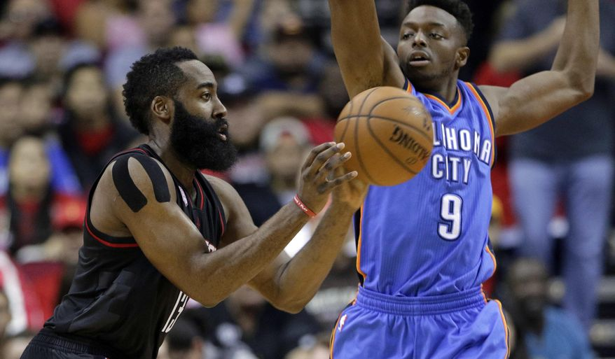 Houston Rockets' James Harden passes under pressure from Oklahoma City Thunder's Jerami Grant (9) in the first quarter of an NBA basketball game in Houston, Thursday, Jan. 5, 2017. (AP Photo/Michael Wyke)