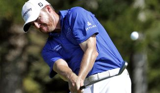 Jimmy Walker hits from the second tee during the first round of the Tournament of Champions golf event, Thursday, Jan. 5, 2017, at Kapalua Plantation Course in Kapalua, Hawaii. (AP Photo/Matt York)
