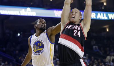 Portland Trail Blazers' Mason Plumlee (24) scores past Golden State Warriors' Kevin Durant (35) during the first half of an NBA basketball game, Wednesday, Jan. 4, 2017, in Oakland, Calif. (AP Photo/Marcio Jose Sanchez)