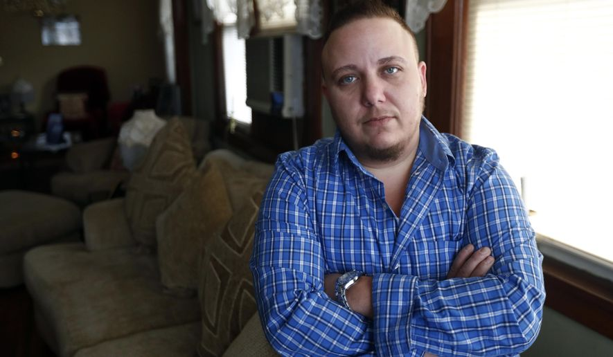 "Jionni Conforti poses for The Associated Press in his home, Thursday, Jan. 5, 2017, in Totowa, N.J. The transgender man has sued St. Joseph's Regional Medical Center in Paterson, N.J., after he said it cited religion in refusing to allow his surgeon to perform a hysterectomy procedure he said was medically necessary as part of his gender transition. Conforti had scheduled the surgery in 2015, but he alleges in the federal lawsuit that a hospital administrator then told him the procedure to remove the uterus he was born with couldn't be done because it was a ""Catholic hospital."" (AP Photo/Julio Cortez)"