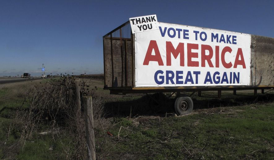 This Dec. 17, 2016 photo shows a Donald Trump campaign sign along a highway near Los Banos, Calif. A California farmer says Donald Trump's campaign vow to deport millions of immigrants who are in the country illegally pushed him into buying more equipment, cutting the number of workers he'll need during the next harvest. Others in California's farming industry say Trump's tough campaign talk targeting immigrants in the country illegally, including a vast number of farmworkers, spurred them into action, too. (AP Photo/Scott Smith)