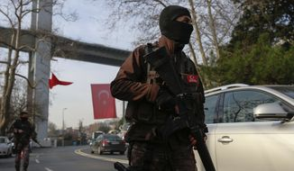 Turkish special security force members patrol near the scene of the Reina night club following the New Year's day attack, in Istanbul, Wednesday, Jan. 4, 2017. Turkey has identified the gunman in the Istanbul nightclub massacre, the foreign minister said Wednesday as the president vowed that the country won't surrender to terrorists or become divided. (AP Photo/Emrah Gurel)