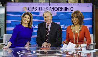 """This Dec. 7, 2016 image released by CBS shows, from left, Norah O'Donnell, Charlie Rose and Gayle King on the set of """"CBS This Morning,"""" in New York. (Michele Crowe/CBS via AP)"""