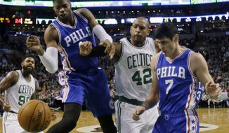 Boston Celtics center Al Horford (42) is boxed out from the rebound by Philadelphia 76ers forwards Nerlens Noel, left, and Ersan Ilyasova (7) in the first quarter of an NBA basketball game, Friday, Jan. 6, 2017, in Boston. (AP Photo/Elise Amendola)