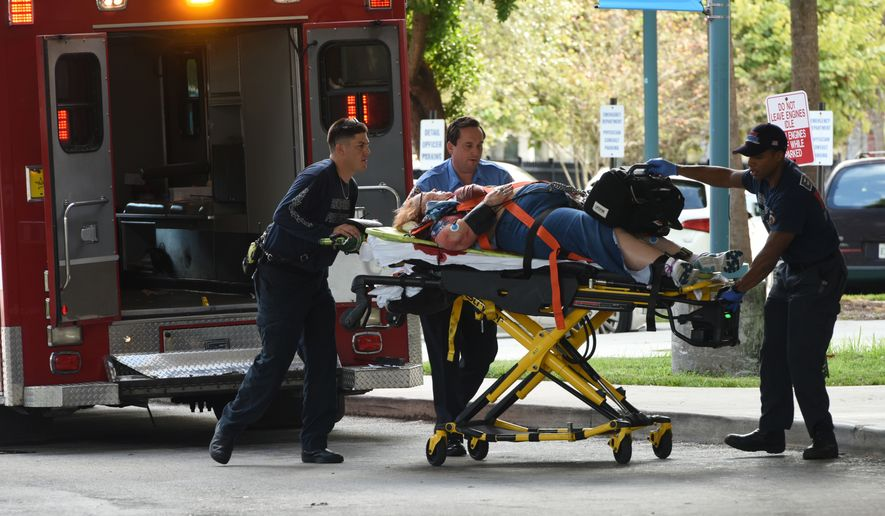 "An injured woman is taken into Broward Health Trauma Center in Fort Lauderdale, Fla., after a shooting at the Fort Lauderdale-Hollywood International Airport on Friday, Jan. 6, 2017. Authorities say a lone shooter opened fire at the airport Friday afternoon, killing ""multiple"" people before he was taken into custody. (Taimy Alvarez/South Florida Sun-Sentinel via AP)"