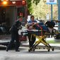"""An injured woman is taken into Broward Health Trauma Center in Fort Lauderdale, Fla., after a shooting at the Fort Lauderdale-Hollywood International Airport on Friday, Jan. 6, 2017. Authorities say a lone shooter opened fire at the airport Friday afternoon, killing """"multiple"""" people before he was taken into custody. (Taimy Alvarez/South Florida Sun-Sentinel via AP)"""