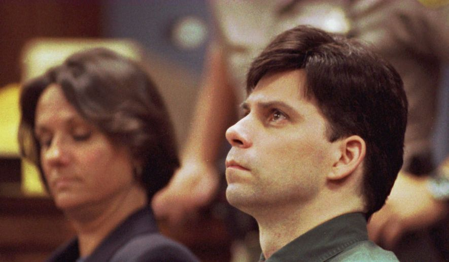 Lyle Menendez looks up during testimony in his and brother Erik's retrial for the shotgun slayings of their parents in Los Angeles, in this Oct. 20, 1995, file photo. With Lyle is his attorney Terri Towery. Menendez told ABC News in a phone interview from a California prison released Jan. 5, 2017, that he maintains a close bond with his brother, even though he is being housed at a separate facility. (Steve Grayson/UPI via AP, Pool, File)