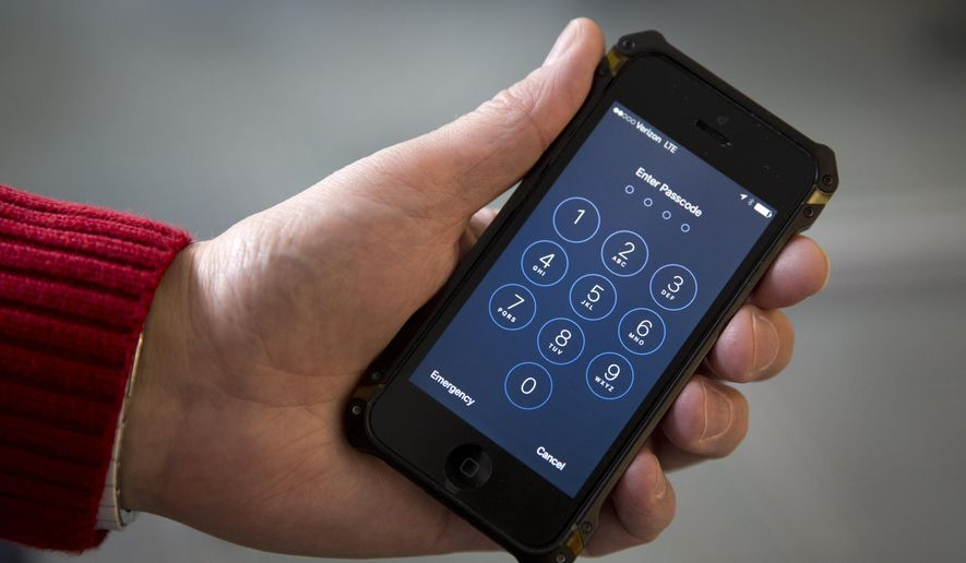 FILE - In this Feb. 17, 2016 file photo an iPhone is seen in Washington. The FBI on Jan. 6, 2017 released 100 pages of heavily censored documents related to its agreement with a mysterious vendor to hack into an iPhone used by one of the San Bernardino shooters, but it did not identify who it paid to perform the work or how much it cost. (AP Photo/Carolyn Kaster, File)