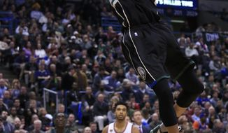 Milwaukee Bucks forward Giannis Antetokounmpo, top, slam-dunks against the New York Knicks during the second half of an NBA basketball game Friday, Jan. 6, 2017, in Milwaukee. (AP Photo/Darren Hauck)