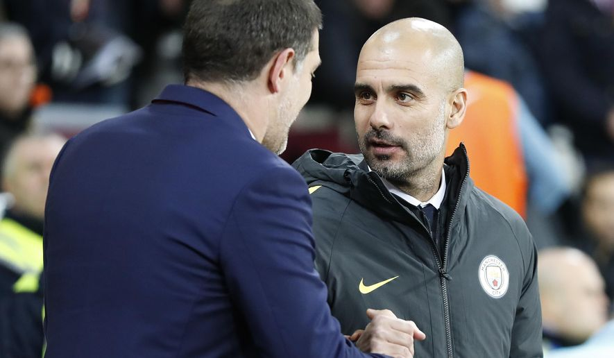 West Ham's manager Slaven Bilic, left, shakes hands with Manchester City's manager Pep Guardiola ahead of the FA Cup third round soccer match between West Ham United and Manchester City at the London stadium in London, Friday, Jan. 6, 2017. (AP Photo/Kirsty Wigglesworth)