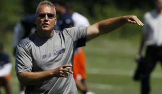 FILE - In this June 12, 2012, file photo, then-Chicago Bears special teams coach Dave Taub gestures during practice in Lake Forest, Ill. Broncos general manager John Elway began his third coaching search in six seasons with a visit to Kansas City on Friday, Jan. 6, 2017,  to interview Chiefs special teams coach Dave Toub.Elway and his committee, which includes team president Joe Ellis and player personnel director Matt Russell, will then travel to Atlanta to meet with Falcons offensive coordinator Kyle Shanahan over the weekend. (AP Photo/Charles Rex Arbogast, File)