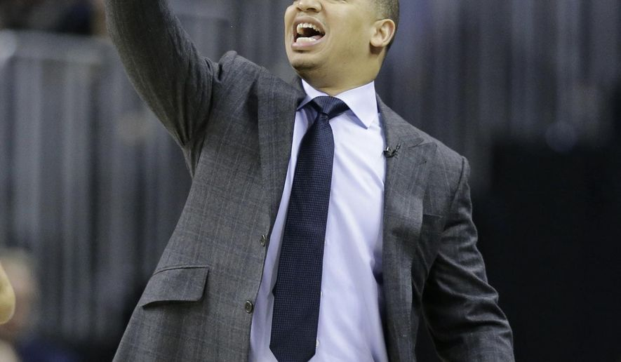 Cleveland Cavaliers head coach Tyronn Lue yells to players in the first half of an NBA basketball game against the Chicago Bulls, Wednesday, Jan. 4, 2017, in Cleveland. The Bulls won 106-94. (AP Photo/Tony Dejak)
