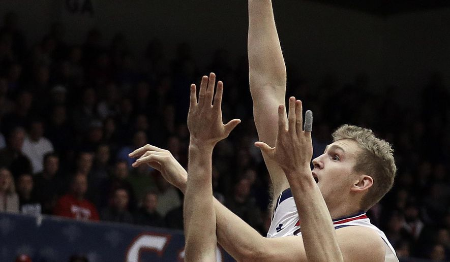 Saint Mary's Jock Landale right, shoots against BYU forward Eric Mika during the first half of an NCAA college basketball game Thursday, Jan. 5, 2017, in Moraga, Calif. (AP Photo/Ben Margot)
