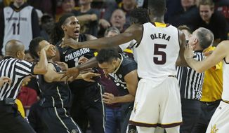 Arizona's Jethro Tshisumpa, behind Obinna Oleka (5) and Colorado's Xavier Johnson (11) scuffle after a foul in the first half of an NCAA college basketball in  in Tempe, Ariz., Thursday, Jan. 5, 2017. Tshisumpa and Johnson were ejected after an altercation. (Patrick Breen/The Arizona Republic via AP)