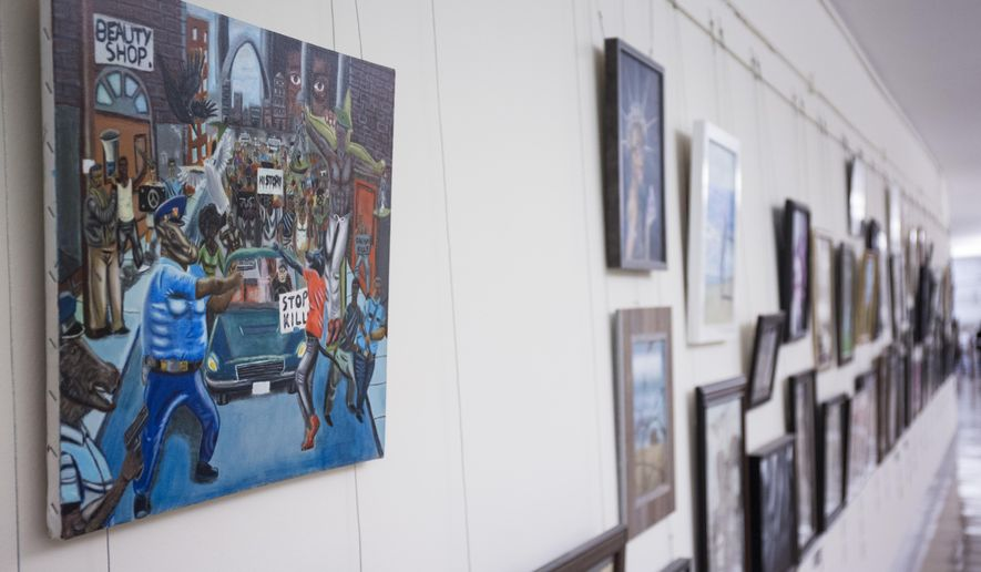 In this Jan. 5, 2017, photo, a painting by David Pulphus hangs in a hallway displaying paintings by high school students selected by their member of congress on Capitol Hill in Washington. Rep. Duncan Hunter, R-Calif., has removed a painting that showed a pig in a police uniform, one of hundreds of artworks on display at the Capitol and sponsored by a member of Congress. Joe Kasper, a spokesman forHunter, says the lawmaker unscrewed the artwork from the display and returned it to the office of Missouri Democratic Rep. William Lacy Clay. (AP Photo/Zach Gibson)