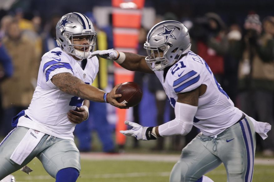 FILE - In this Sunday, Dec. 11, 2016 file photo, Dallas Cowboys quarterback Dak Prescott (4) hands the ball to Ezekiel Elliott (21) during the second half of an NFL football game against the New York Giants in East Rutherford, N.J. Ezekiel Elliott pelted fellow rookie Dak Prescott with straw wrappers and a spitball when the Dallas quarterback was surrounded by reporters, trying to explain how he kept the task of replacing Tony Romo from becoming too big. (AP Photo/Seth Wenig, File)