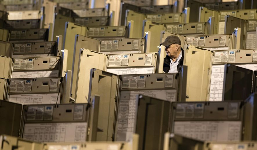 FILE - In this Oct. 14, 2016, file photo, a technician works to prepare voting machines to be used in the presidential election, in Philadelphia. Homeland Security Secretary Jeh Johnson has told state officials that he is moving toward designating U.S. election systems as critical infrastructure, a designation that will provide more federal help for states to keep election systems safe from tampering. (AP Photo/Matt Rourke, File)