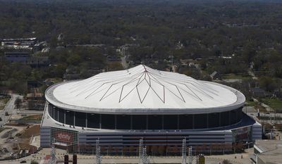 In this Monday, March 31, 2014, photo, the Georgia Dome is shown, in Atlanta. The Georgia Dome, which in 1992 became the Atlanta Falcons' home, also has been home to Georgia State football, high school state championships, Peach Bowls and SEC championship games, two Super Bowls and three Final Fours, will make way for the new Mercedes Benz Stadium.(AP Photo/Mike Stewart)