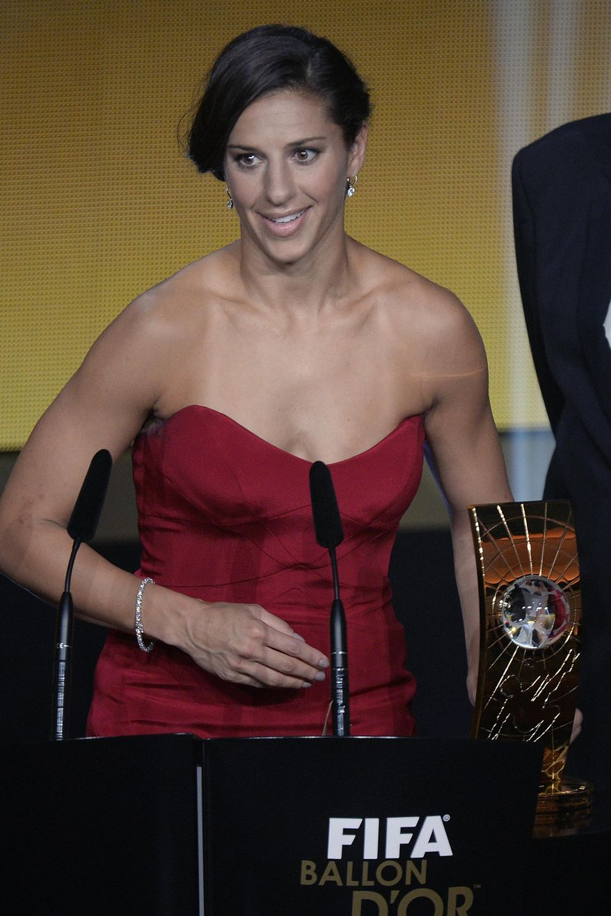 FILE - In this Jan. 11, 2016 file photo, Carli Lloyd of the US delivers a speech after winning the FIFA Women's soccer player of the year 2015 prize during the FIFA Ballon d'Or awarding ceremony at the Kongresshaus in Zurich, Switzerland. Carli Lloyd is shortlisted 2016 FIFA women's player of the year with Melanie Behringer and five-time winner Marta of Brazil. (Walter Bieri/Keystone via AP, File)