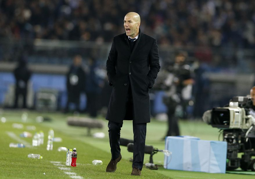 FILE - In this file photo dated Sunday, Dec. 18, 2016, Real Madrid's head coach Zinedine Zidane shouts instructions during the final of the FIFA Club World Cup soccer tournament against Kashima Antler in Yokohama, near Tokyo, Japan. Zidane is shortlisted for the men's coaching award at the FIFA awards on Monday Jan. 9, 2017. (AP Photo/Shuji Kajiyama, file)
